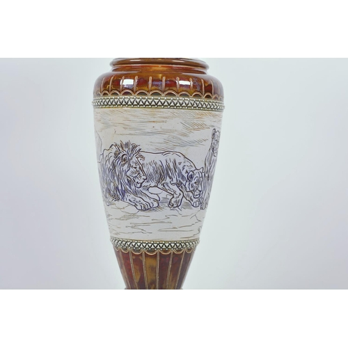 42 - Hannah Barlow for Doulton Lambeth, a stoneware vase decorated with a pride of lions on a buff ground...