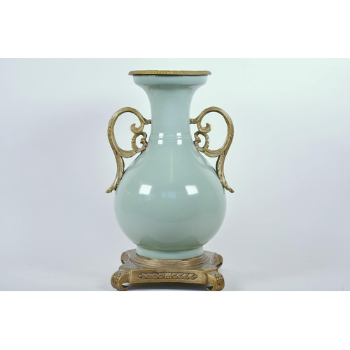 43 - A Chinese celadon glazed porcelain vase with ormolu style mount and raised floral decoration, seal m...