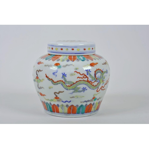 45 - A Chinese doucai porcelain ginger jar and cover, decorated with dragons chasing the flaming pearl, 5...