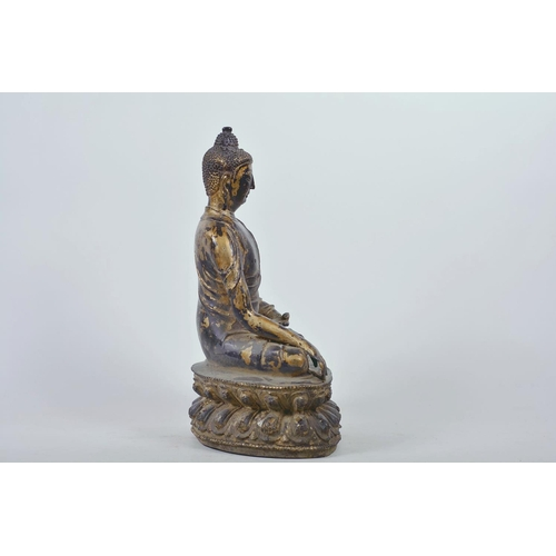 47 - A Chinese patinated bronze figure of Buddha seated in meditation, 12