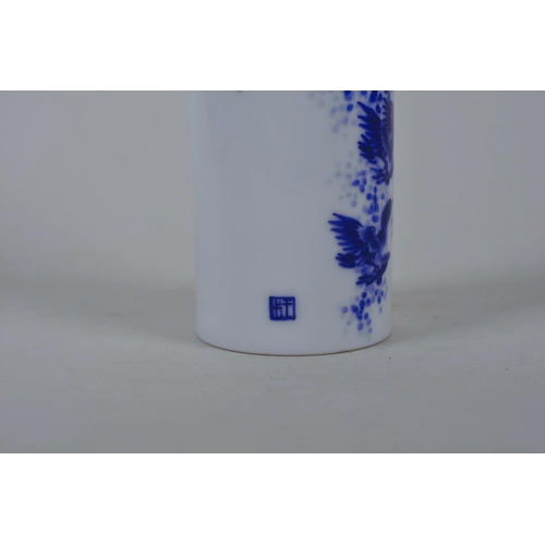 50 - A Chinese blue and white porcelain cylinder vase/brush pot decorated with birds in flight, seal mark...