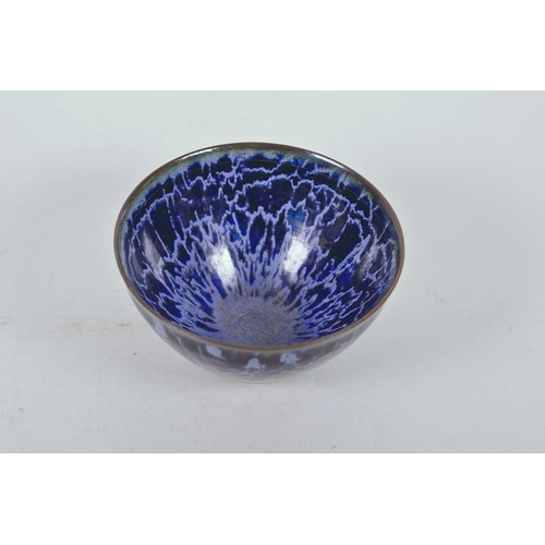 52 - A Chinese Jian kiln bowl with high fired blue drip glaze, impressed character mark to base, 5¼