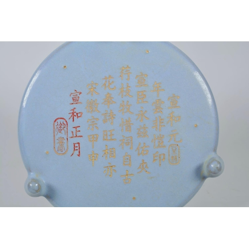 58 - A Chinese Song style dish on tripod feet with a Ru ware glaze, engraved and gilt character inscripti...