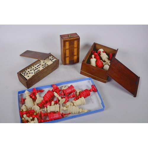 7 - A box of vintage games including two dyed bone part chess sets, crib board and dominoes...