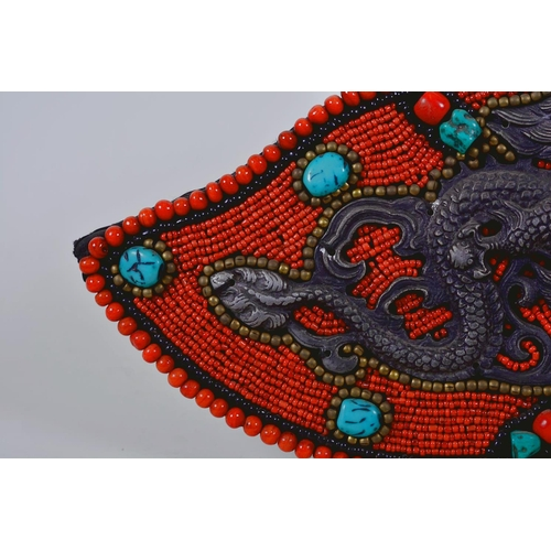 8 - A Tibetan wall hanging decorated with agate, coral and turquoise beads, 13