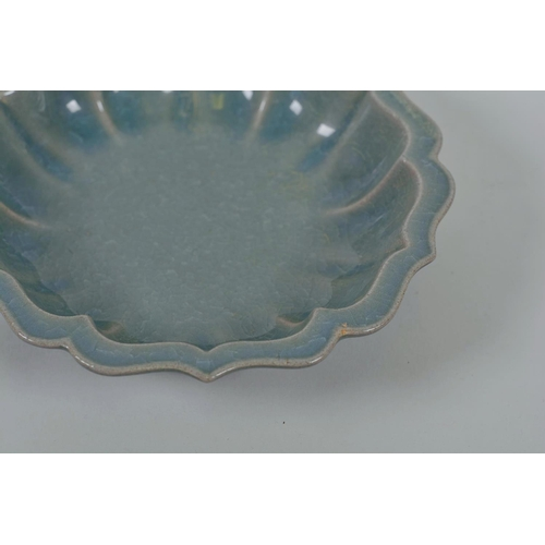 35 - A Chinese celadon crackle glazed Ru ware style dish of lobed form, 7½