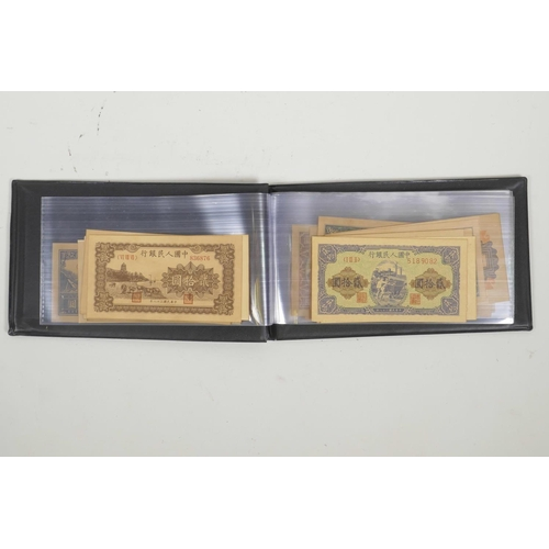 10 - A wallet of Chinese facsimile (replica) banknotes of assorted denominations, 8½
