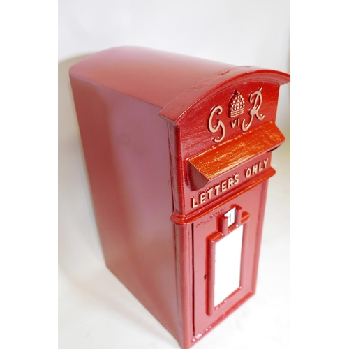 17 - A cast iron and metal postbox with key, 23