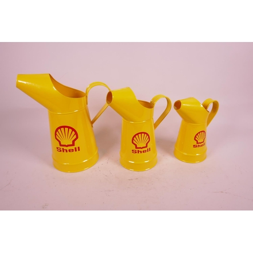 2 - A set of three replica oil jugs decorated with the Shell logo, largest 10