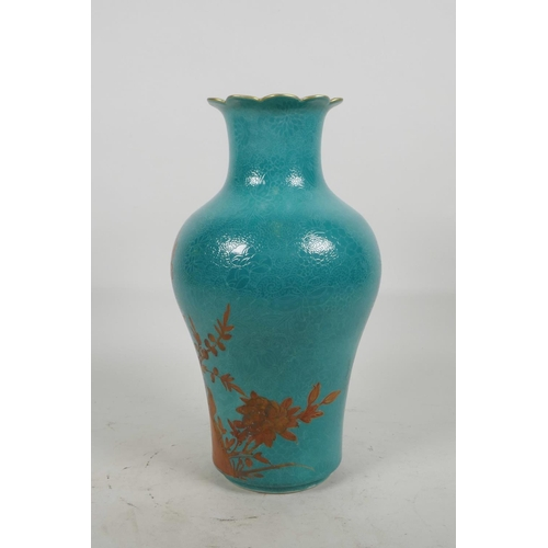 20 - A Chinese blue ground porcelain vase with incised self coloured floral decoration, overpainted with ...