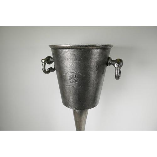 21 - A cast aluminium pedestal ice bucket, 31