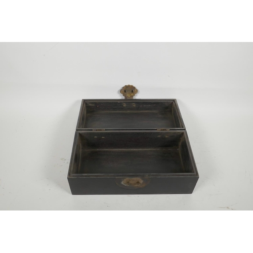 22 - An oriental ebonised hardwood box, with brass fittings, 10