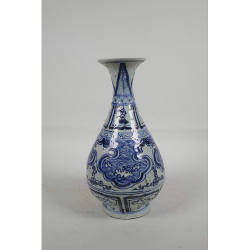 24 - A Chinese blue and white porcelain pear shaped vase with flared rim and stylised decoration, 10