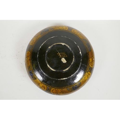 26 - A Kashmiri brass and lacquer bowl with a rolled rim, decorated with gilt floral patterns, signed to ...