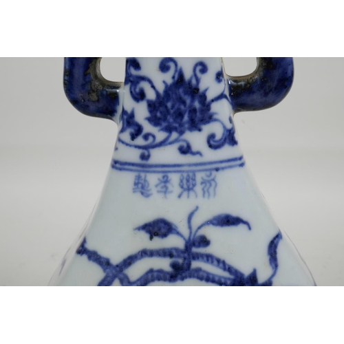 30 - A Chinese blue and white porcelain sectional vase with two lug handles and trailing branch decoratio...