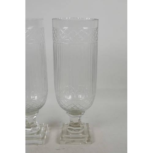 31 - A pair of cut glass hurricane vases , 13