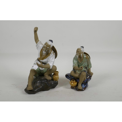 34 - Two oriental porcelain figurines of fishermen, largest 8