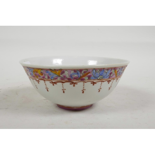 37 - A Chinese Republic porcelain rice bowl decorated in the famille rose palette, character mark to base...
