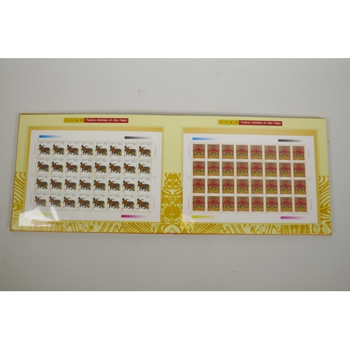 40 - An album of Chinese facsimile (replica) stamp sheets depicting the twelve animals of the Zodiac, dat...