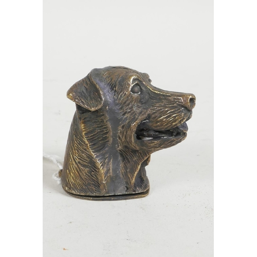 49 - A brass vesta case in the form of a dog's head, 1½