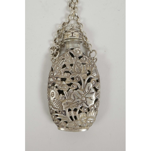 5 - A Chinese white metal scent holder with pierced decoration of carp and lotus flowers, 6½