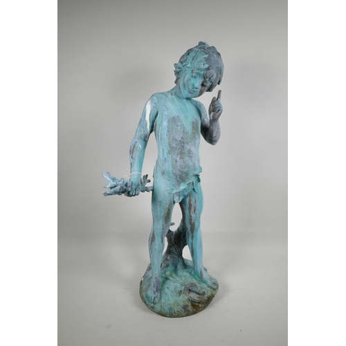 50 - A verdigris bronze garden figure of Pan holding a branch with two perching birds, 26
