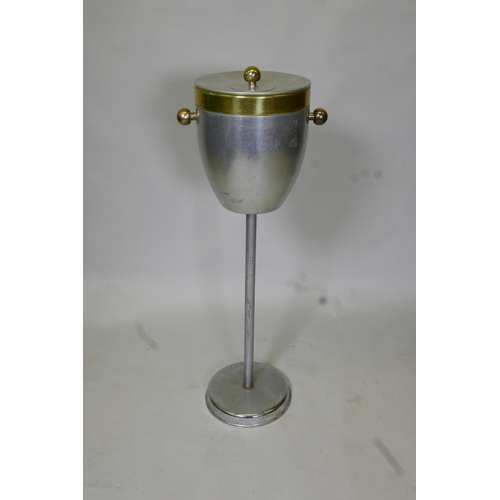 53 - A vintage metal ice bucket on stand with a plastic liner, 31