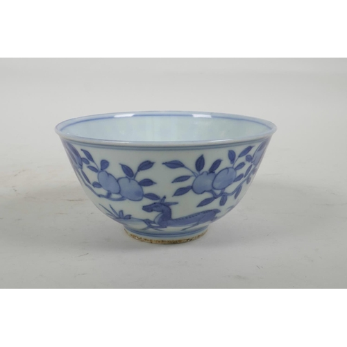 54 - A Chinese blue and white porcelain rice bowl decorated with deer amongst trees, six character mark t...