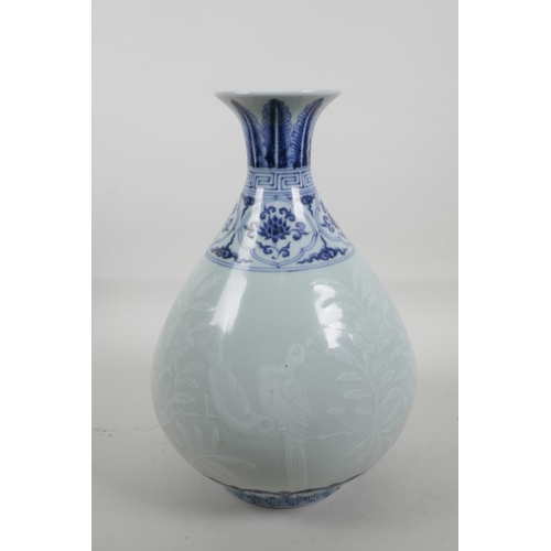55 - A Chinese blue and white porcelain pear shaped vase with a flared rim, decorated with birds amongst ...