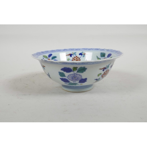 56 - A Chinese Doucai porcelain bowl with lobed rim painted with flowers, six character mark to base, 6