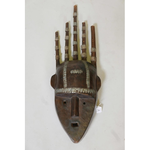 57 - A West African hardwood Bambara N'tomo mask with metal banded decoration, 28