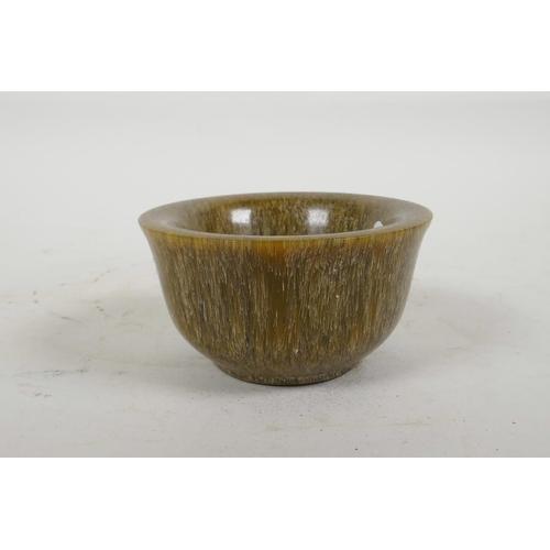 58 - A Chinese faux horn tea bowl, 3½