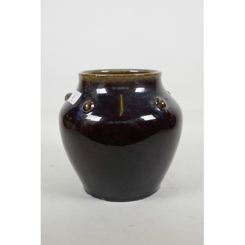 6 - A Chinese porcelain purple flambé glazed vase with embossed decoration to the shoulders, mark to bas...