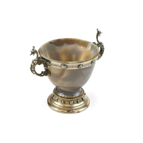 11 - Silver and Agate Cup - A Silver and agate cup, the two silver handles modelled as dragons, the silve...