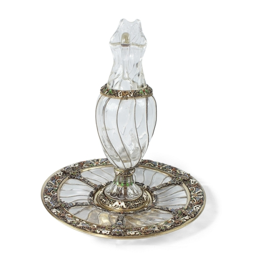 60 - Rock Crystal Ewer and Tray - Viennese Silver Gilt - The rock crystal carved with swirling flutes enh...