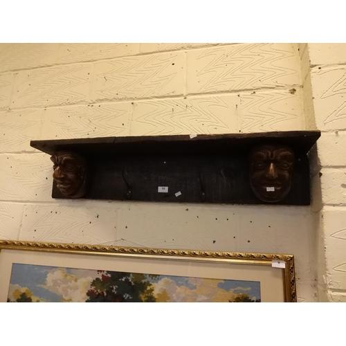 10 - (Ref 1) Vintage style shelf and coat hanger 2x gothic heads with 2 coat hooks...