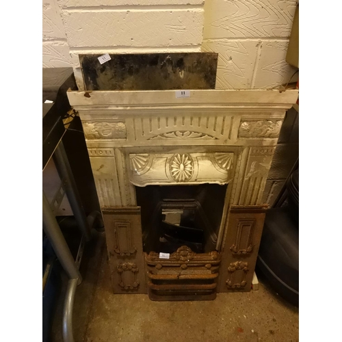 11 - Victorian/Edwardian cast iron fire surround and other parts to fires from local pub...