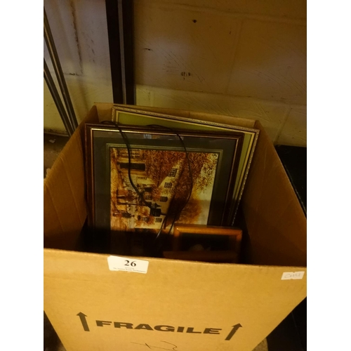 26 - Box of assorted frames including boat/sunset scene, two framed pictures of raccoons, a tapestry plus...