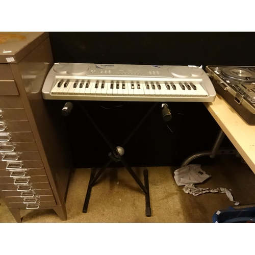 4 - Acoustic solutions 49 keys multifunctional electronic keyboard with stand in working order...