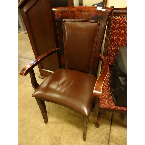 41 - Dark wood and brown leather open arm carver chair...