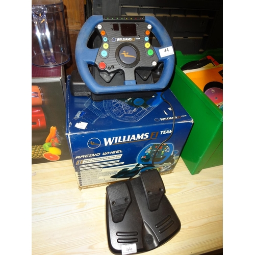 44 - Playstation Williams F.1 Racing wheel game boxed...