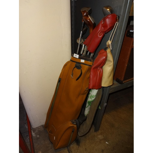 24 - Light brown bag of right handed golf clubs of various makes including Goudie drivers 1-3-5 and Goudi...