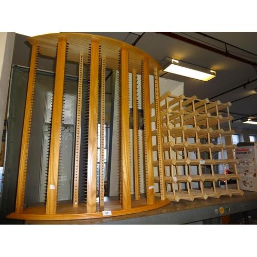 25 - Pine 30 bottle wine rack 58cm x 68cm and cd rack holds approximately 280 Cd's 83cm W x 29cm D x 89cm...
