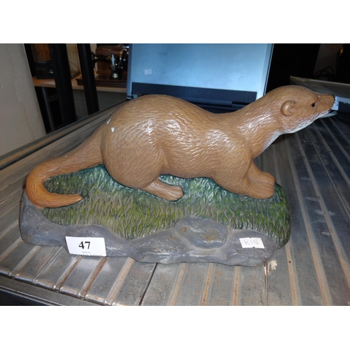 47 - Otter cast iron door stop...