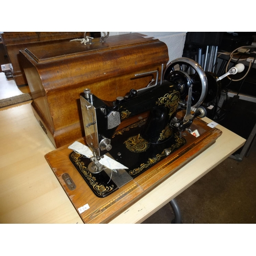 6 - Vintage/antique hand cranked sewing machine with case and key in good condition...