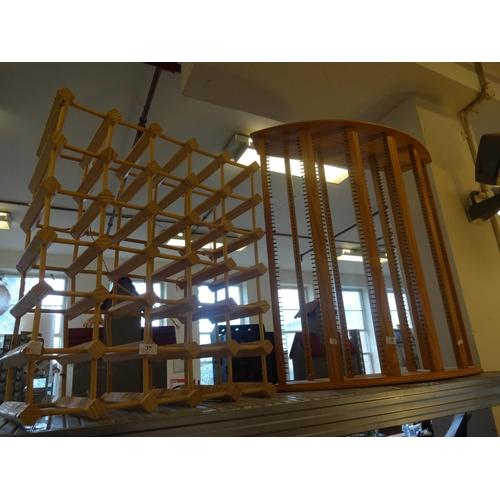 37 - Pine 30 bottle wine rack 58cm x 68cm and cd rack holds approximately 280 Cd's 83cm W x 29cm D x 89cm...