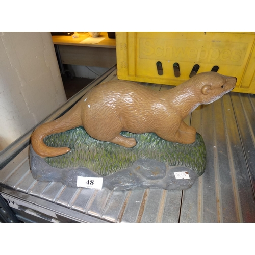 48 - Otter cast iron door stop...