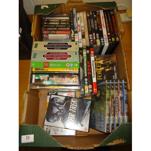 21 - Fruit box containing a selection of CD's and videos, some box sets...