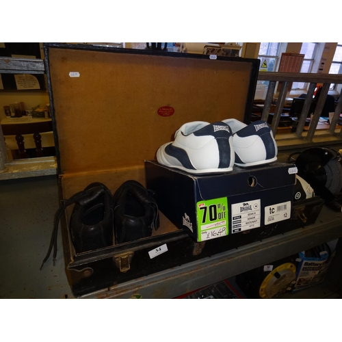 34 - Large black case with 3 pairs of footware, size 12 white and navy retrofire, size 12 white and nave ...