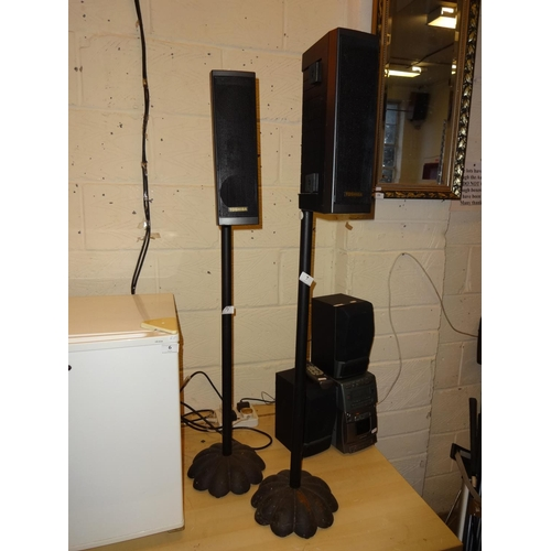 7 - Pair of Toshiba speakers mounted on cast iron stands 109cm high...